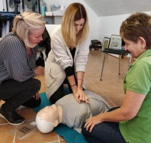 Bodyworks Team practising CPR on their First Aid Course